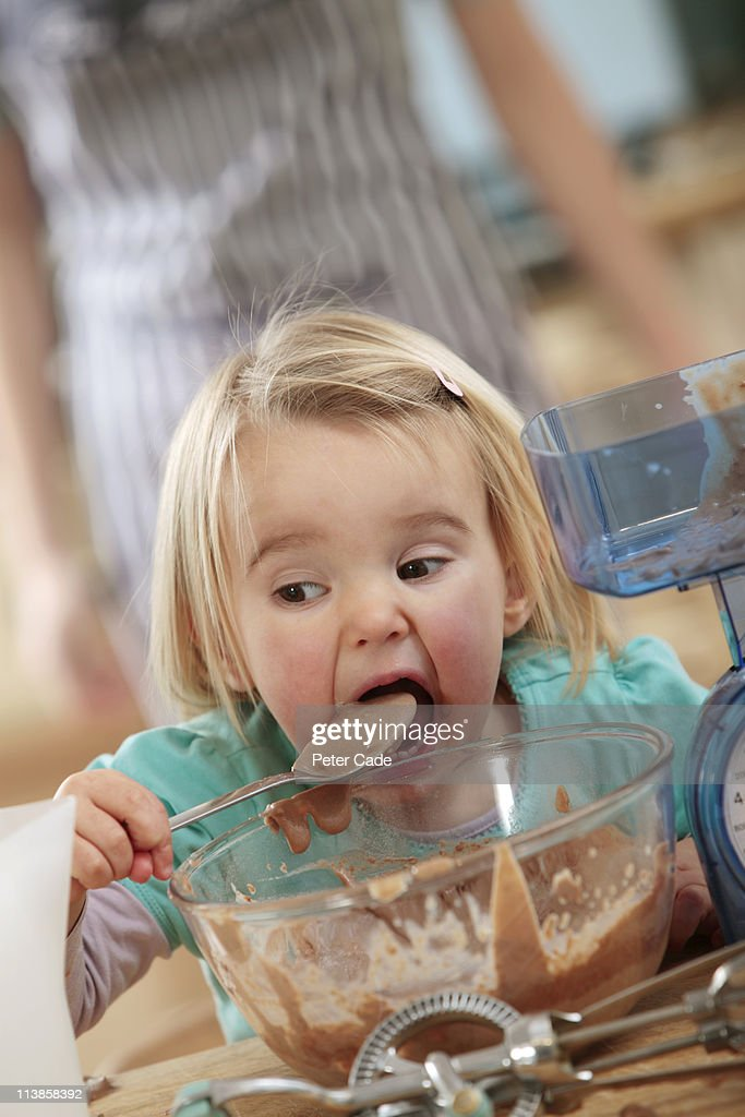 young girl cooking with chocolate : Stock Photo