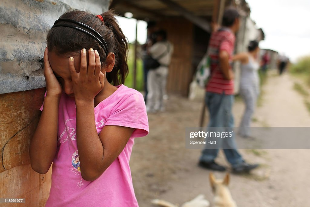 A young girl cries as her home and neighborhood are forcefully dismantled in a shanty town after the government claimed that the settlement was...