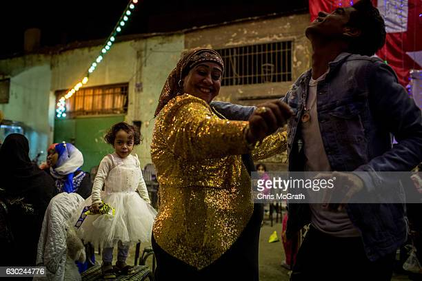 A young girl cries as people dance during a traditional Egyptian Shaaby wedding on December 16 2016 in Cairo Egypt Since the 2011 Arab Spring...
