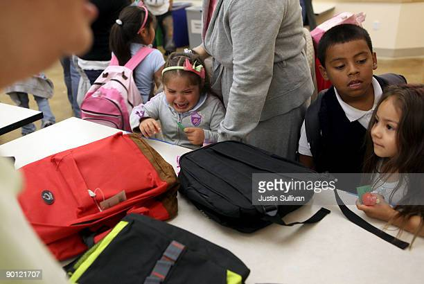 A young girl cries when she found out that there were no more purple backpacks during a backpack giveaway at St Anthony Foundation August 27 2009 in...