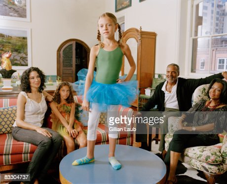 Young girl dancing on coffee table to entertain he : Stock Photo
