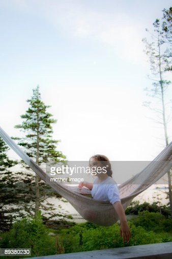 Young girl daydreaming in hammock : Stock Photo