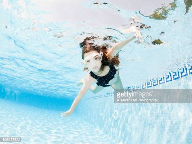 Young girl diving in a swimming-pool