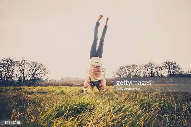 Young girl doing a hand stand