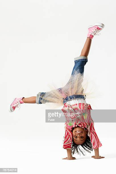 Young Girl Doing Somersault
