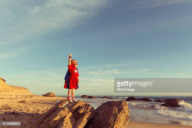 Young Girl dressed as Superhero on California Beach