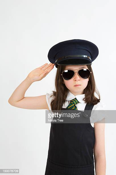 A young girl dressed up as a pilot