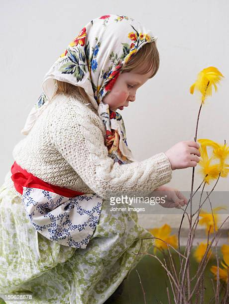 A young girl dressed up as an Easter witch, Sweden.