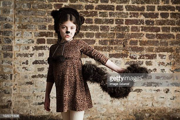 Young girl dressed up as cat