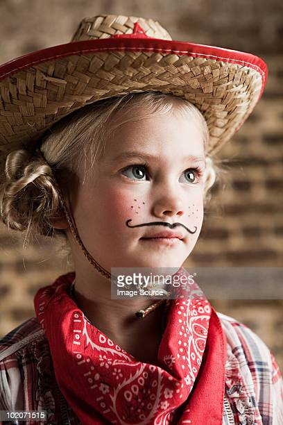 Young girl dressed up as cowgirl