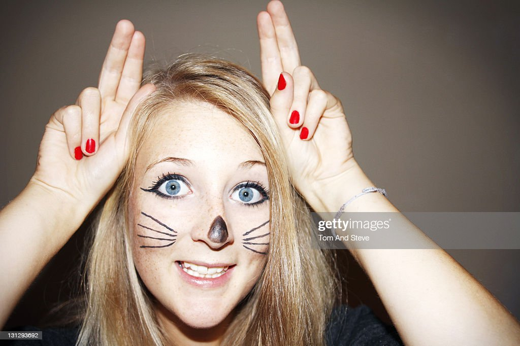 Young girl dresses up as a cat with whiskers : Stock Photo