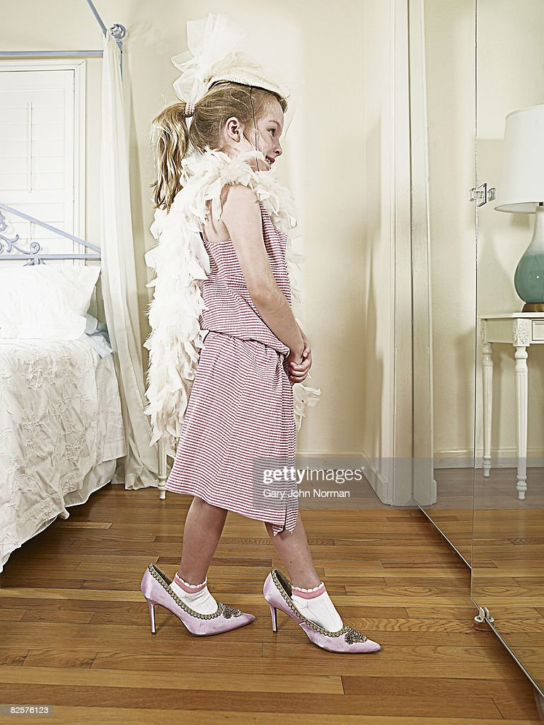 Young girl dresses up  : Stock Photo