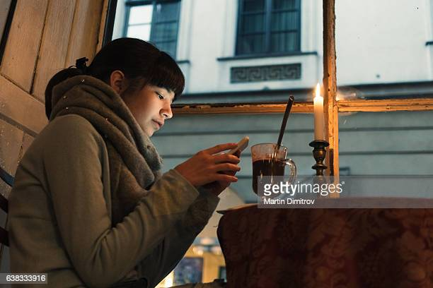 Young girl drinking hot chocolate