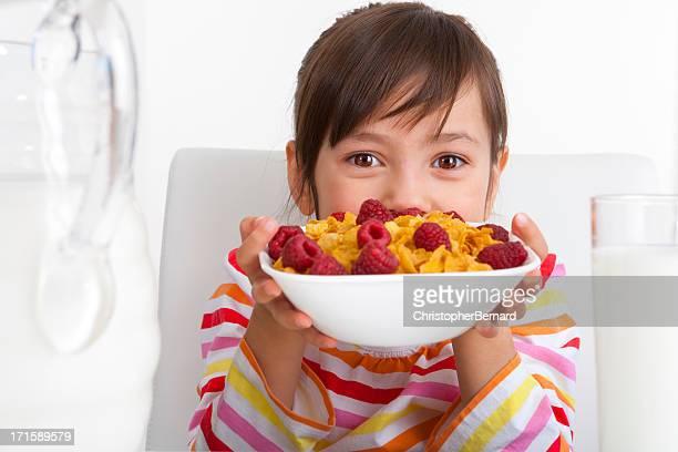 Young girl eating breakfast