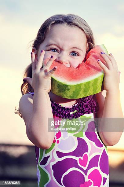 Young Girl Eating Cold Watermelon on a Hot Summer Evening