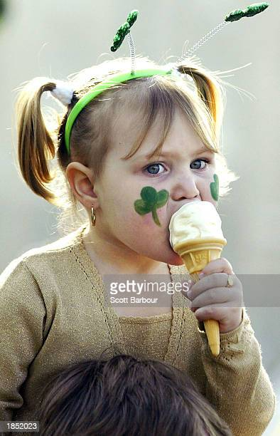 A young girl eats an ice cream during St Patrick's Day celebrations March 16 2003 in London London celebrated Ireland's national day with a parade...