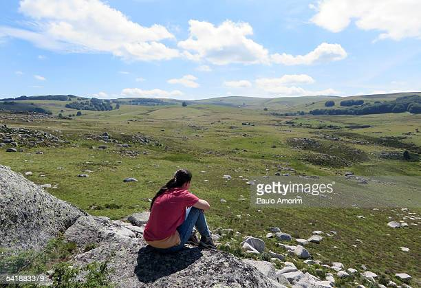 A young girl enjoy at Aubrac plateau in France