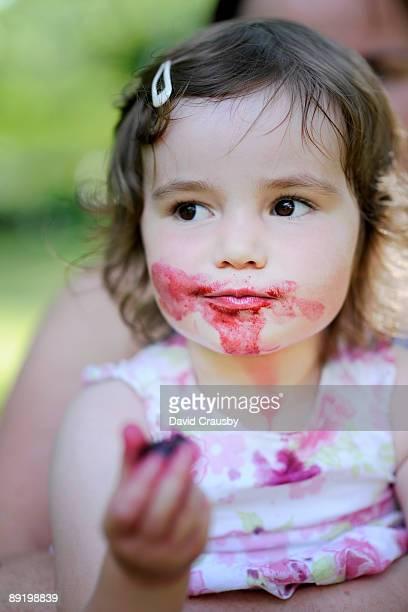 Young Girl enjoying cherries