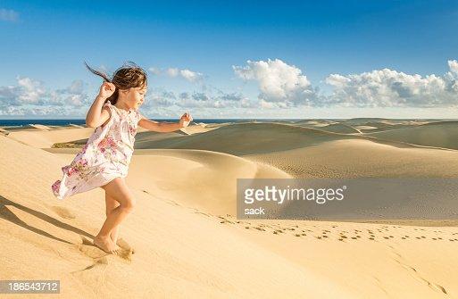 Young girl enjoying the dunes near the beach