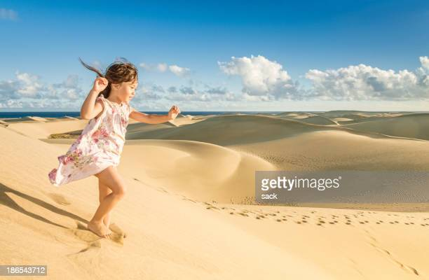 Young girl enjoying the dunes near the beach