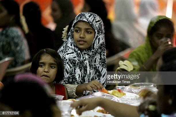 A young girl enjoys the food at the city's firstever allwomen iftar party at St Anthony's Church Dharavi