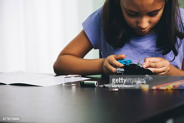 young girl exploring robotics