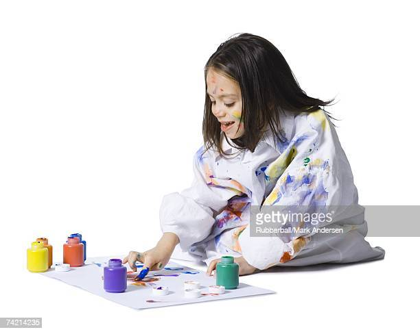 Young girl finger painting