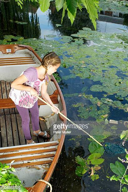 Young girl fishing with net