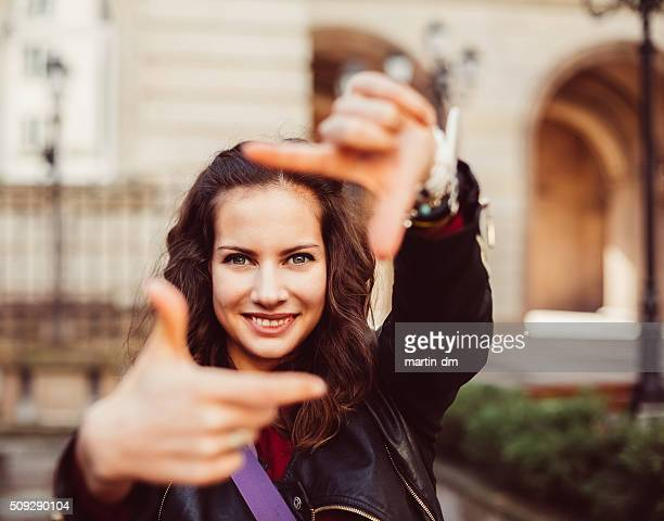 Young girl framing with hands