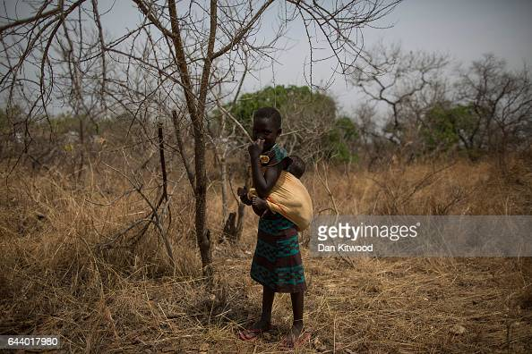 A young girl from South Sudan stands in scrub near the Bidi Bidi refugee camp on February 22 2017 in Arua Uganda The continued flow of refugees from...