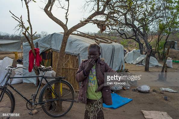 A young girl from South Sudan stands outside her temporary shelter on February 22 2017 in Imvepi Uganda The continuing flow of refugees from South...