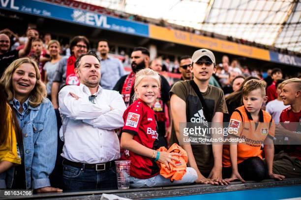 A young girl gets the jersey of Goalkeeper Bernd Leno after the Bundesliga match between Bayer 04 Leverkusen and VfL Wolfsburg at BayArena on October...
