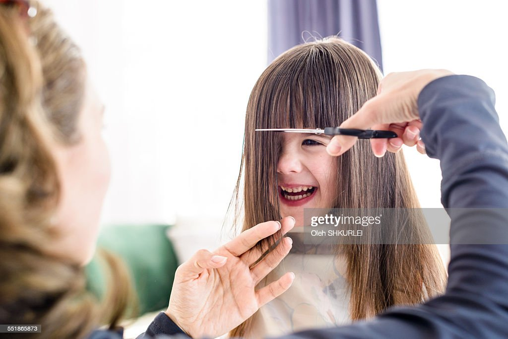 Young Girl Getting Haircut Stock Photo Getty Images