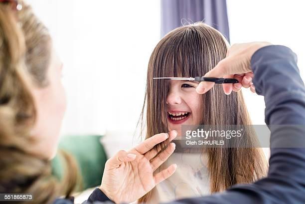 Young girl getting haircut