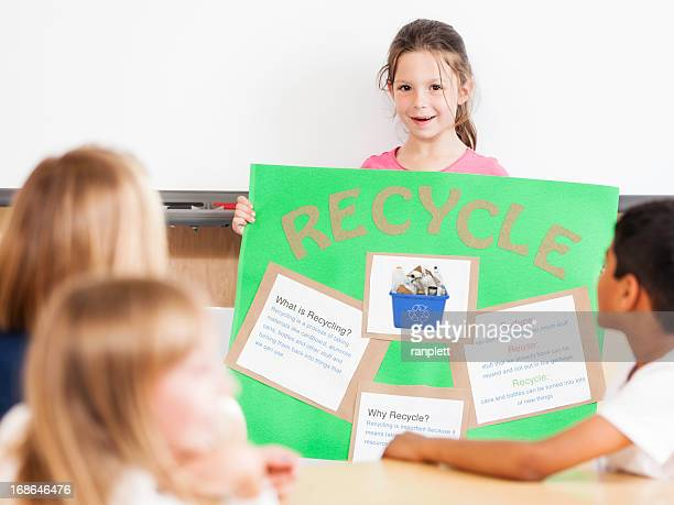 Young Girl Giving a Class Presentation on Recycling