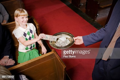Young Girl Giving Money to Church Donations