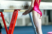 young girl gymnast preparing for her performance on balance beam