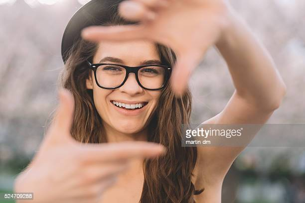 Young girl hand framing