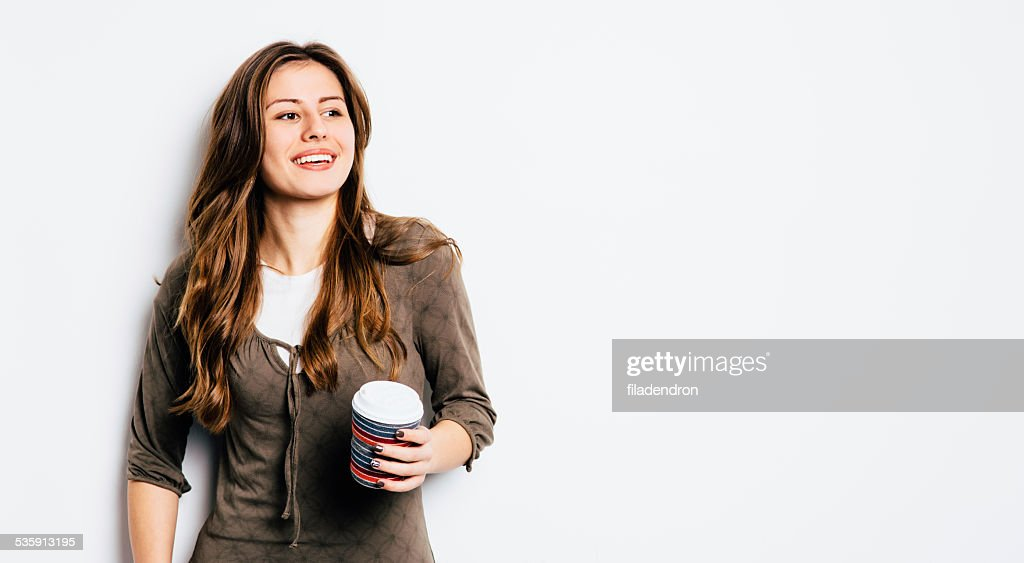 Young girl having a coffee : Stock Photo