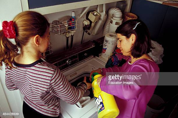 Young Girl Helping Her Mother With Laundry