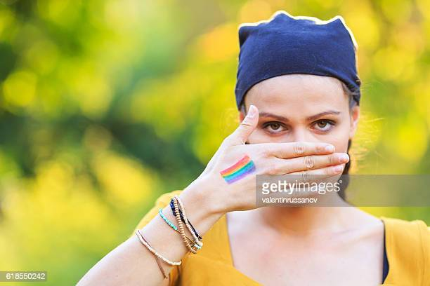 Young girl hiding her mouth