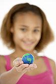 Young Girl Hoiding Small Globe