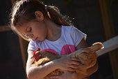 Child holding a chicken