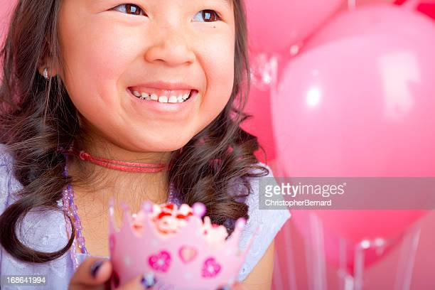 Young girl holding a cupcake