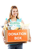Young girl holding a donation box.