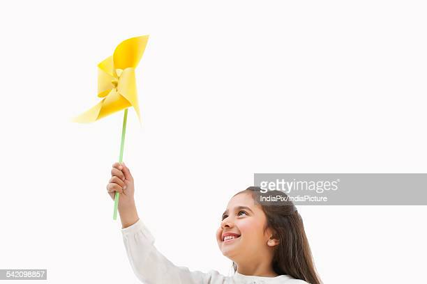 Young girl holding a toy windmill