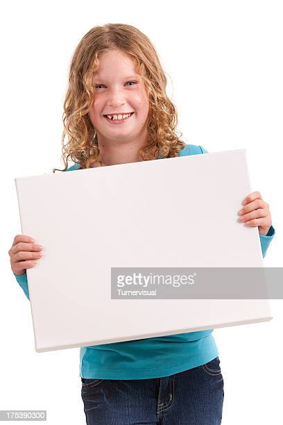 Young Girl Holding Blank Canvas