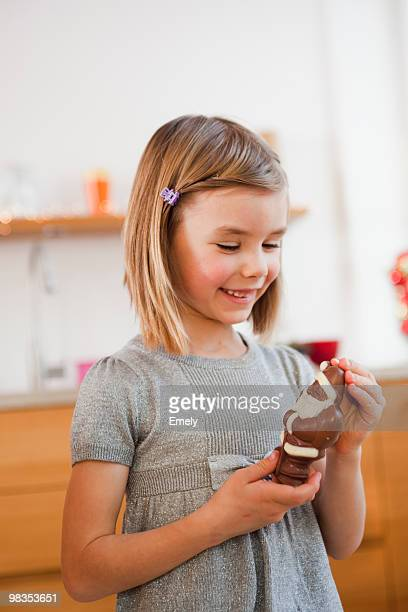 young girl holding chocolate santa claus