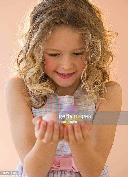 Young girl holding Easter eggs