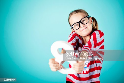 Young girl holding number with geek glasses